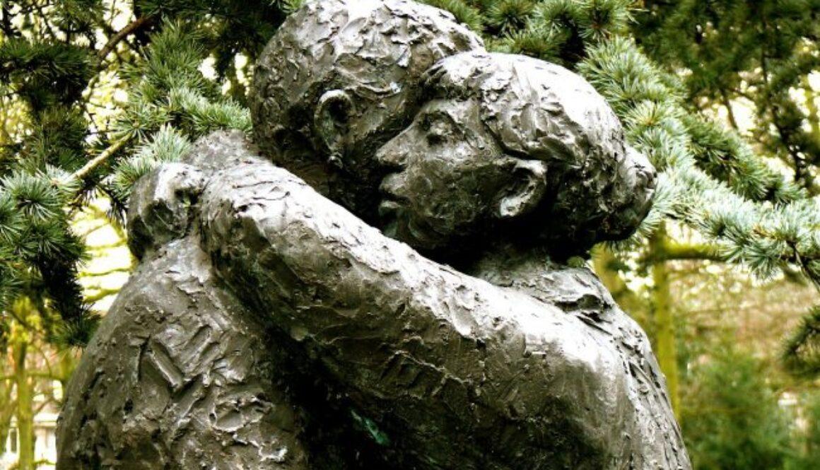 forgive woman hugging man